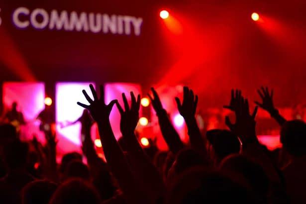 hands raised to join community