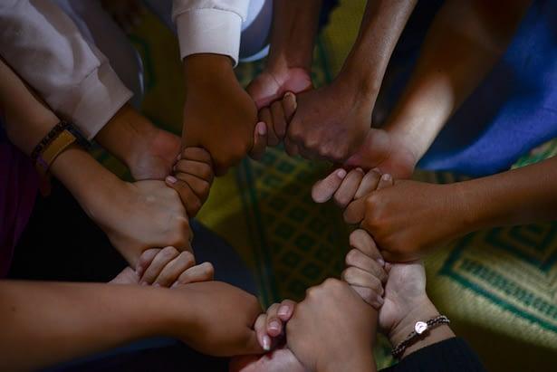 Hands grasping together